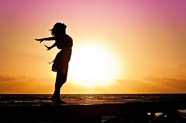 A happy woman on a beach.